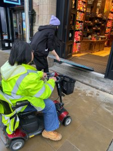 Waiting for the ramp to be installed by a team member outside Lush, Chester