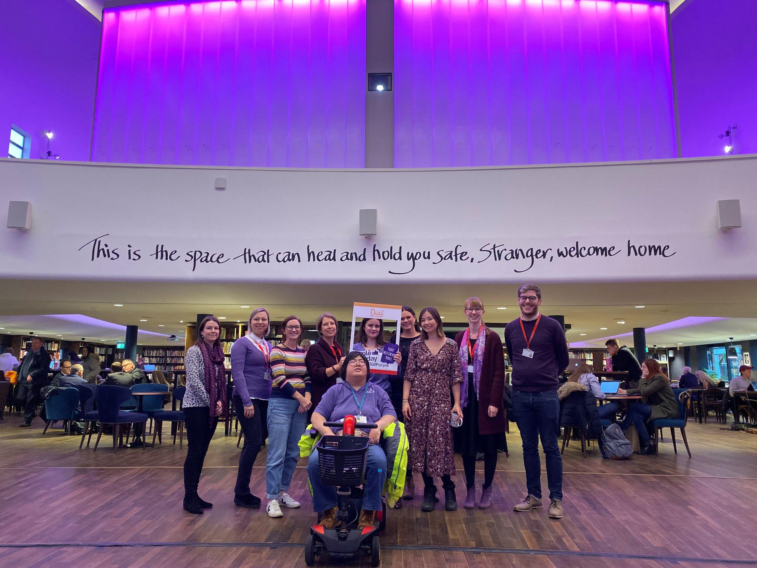 Storyhouse team wearing purple in 2019